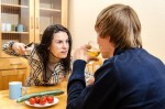 Wife quarrels with her husband in thekitchen