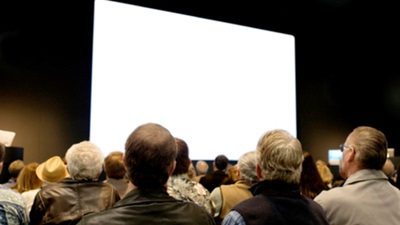 iStock_large_screen_w_audience_Small(1568)_565x318cc