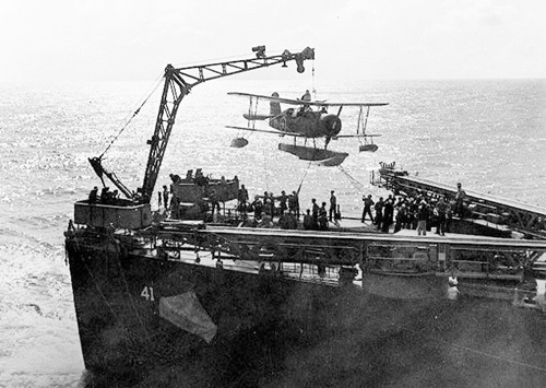SOC_scoutplane_is_hoisted_on_board,_during_recovery_by_USS_Philadelphia_(CL-41)