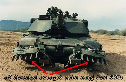 M1 Abrams tank with mine plow_ in forest camo _front_